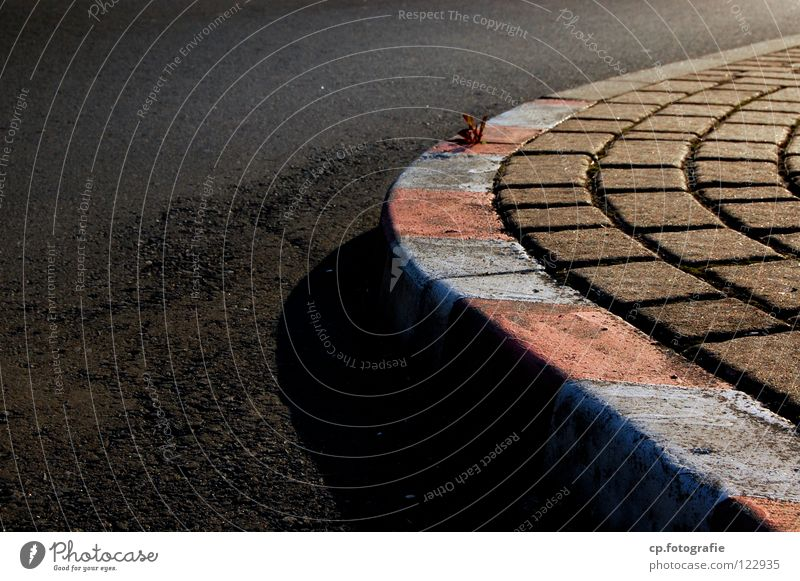 racetrack Asphalt Racecourse Worm's-eye view Evening Town Traffic infrastructure Street Shadow Signs and labeling