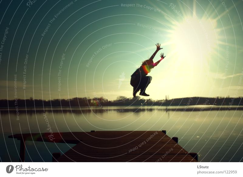 try to reach Joy Contentment Sun Lakeside Jump Tall Attempt Reach Mono Stereo Footbridge Reflection Arm Happy Hover Youth (Young adults) Young woman Ease