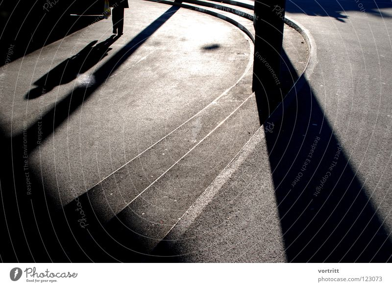 incidence angle Light Winter Concrete Dark Graphic Provocative Visual spectacle Shadow play Modern Human being Column Stairs Sun angle of incidence Loneliness