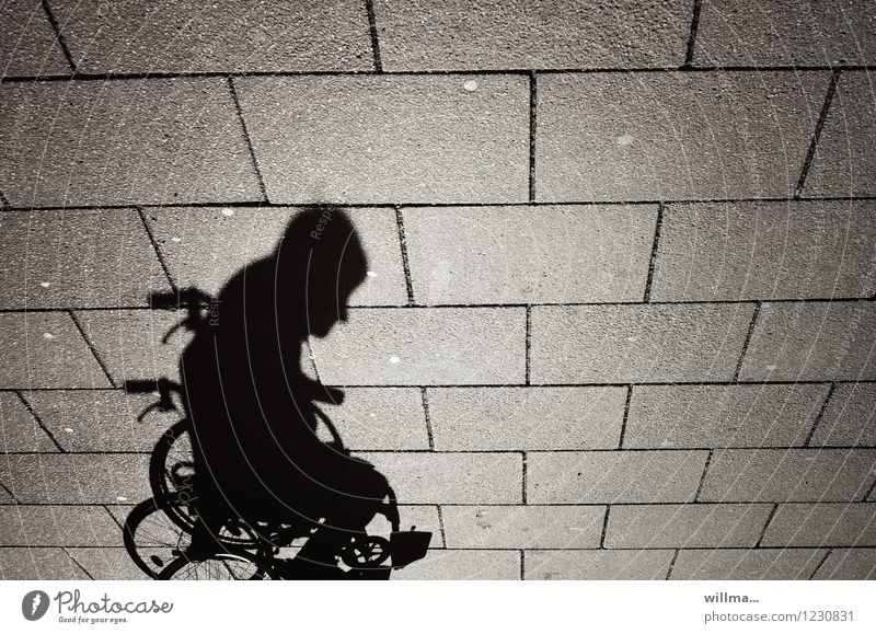 shadow of a person in a wheelchair Human being Man Adults 1 Mobility Wheelchair Shadow Shadow play Dark side Handicapped Paving tiles Shadowy existence