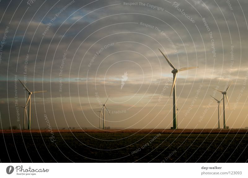 The white giants Clouds Territory Wind energy plant Propeller Provision Electricity Rotation Might Twilight Sunset Light Dark Reflection Electrical equipment