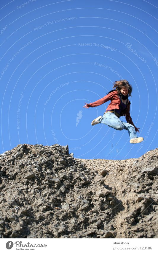 she`s so high Jump Weightlessness Gravity Conquer Easy Ease Action Woman Pebble Building rubble Heap Hill Worm's-eye view Gray Far-off places Under Joy Playing