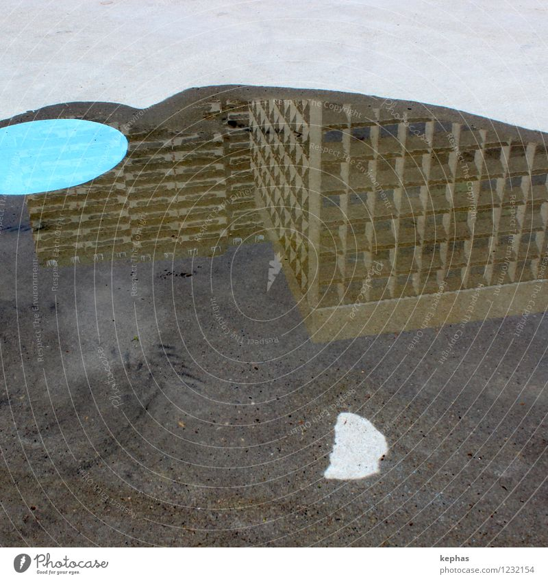 soil art Water Town House (Residential Structure) High-rise Floor covering Concrete Blue Brown Gray Architecture Puddle Circle Mirror image Asphalt Colour photo