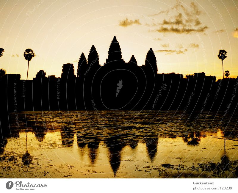 Water Lake Gold Tower Asia Skyline Monument Landmark Dusk Temple House of worship Evening sun Cambodia Angkor Wat Khmer people