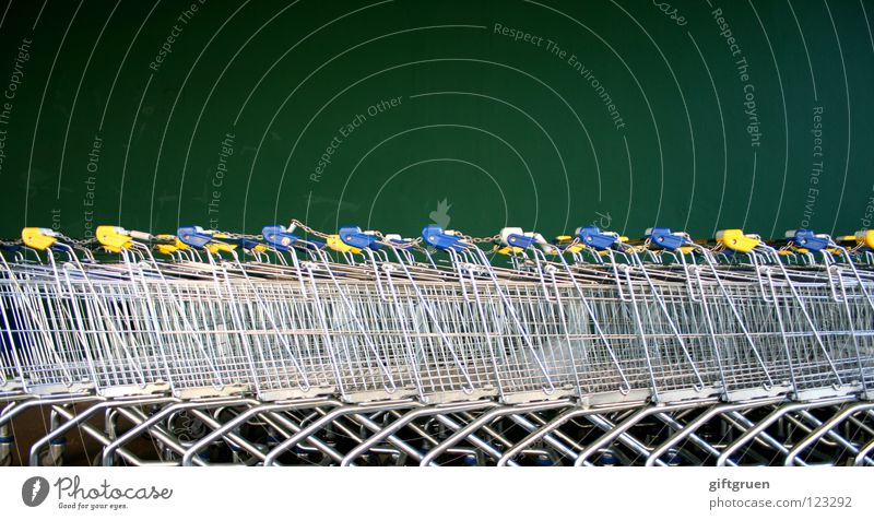 fleet Shopping Trolley Metal Green Supermarket Carriage Wall (building) Consumption Containers and vessels Shopaholic Row Beaded Sequence Structures and shapes