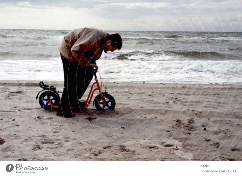 heavy trip Scooter Beach Man Ocean Large Small Slowly Heavy Baltic Sea