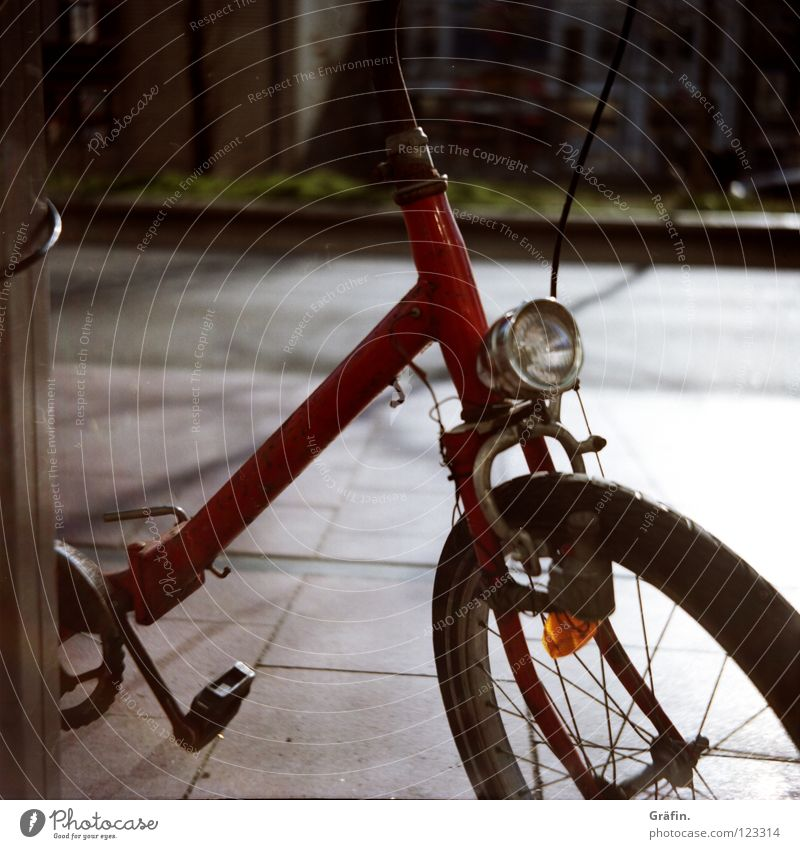 Old Red Street Lamp Bicycle Sidewalk Discover Rust Traffic infrastructure Beautiful weather Roadside Pedal Reeperbahn Sidestreet Chained up Folding bicycle