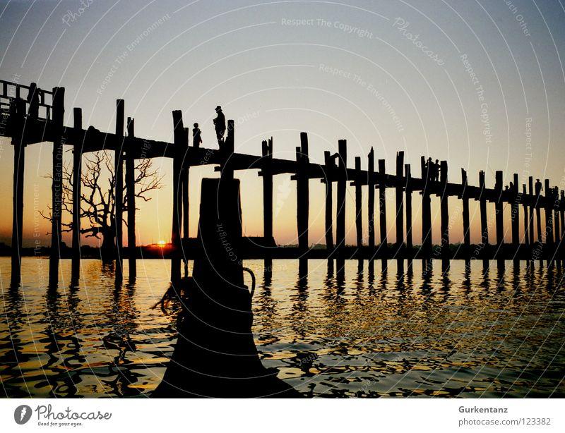 figurehead Myanmar Mandalay Teak Watercraft Figure-head Wood Wooden bridge Asia Dusk Lake Bridge Navigation u-leg Pole Evening