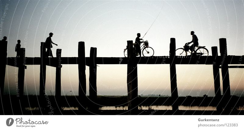 Human being Water Wood Lake Bicycle Transport Bridge Asia Connection Shadow Silhouette Dusk Pole Myanmar Teak