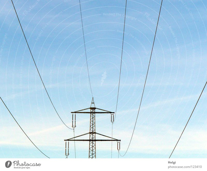 Power pole with power lines stands in front of blue sky with clouds Electricity pylon Wire Large Might Geometry Steel Towering Dangerous Transmission lines