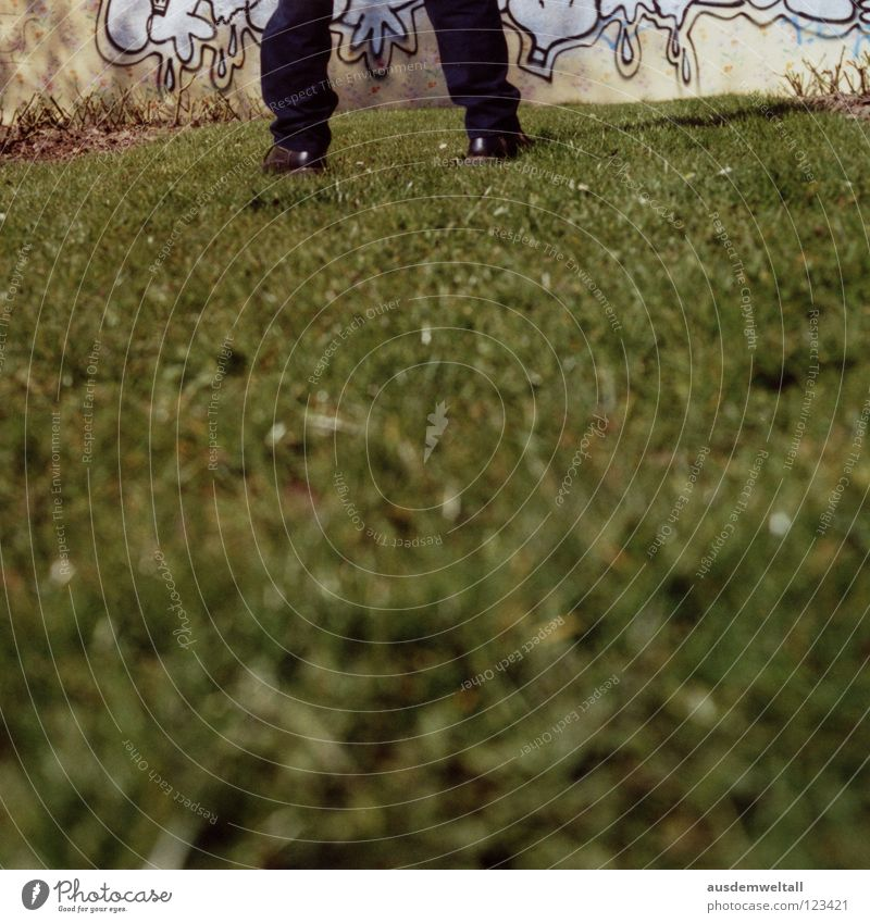 Man Green Black House (Residential Structure) Meadow Graffiti Wall (building) Grass Feet Footwear Stand Beautiful weather Painting (action, work) Pants Analog