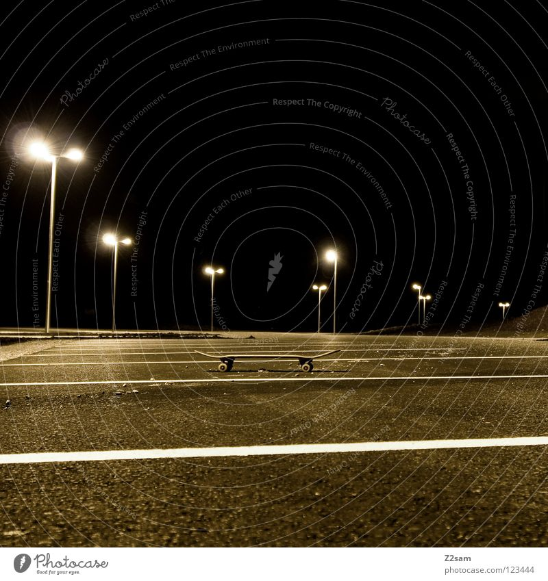 PARK-AND-SKATE Parking Parking lot Lantern Night Dark Physics Tar Concrete Stand Skateboarding Sports equipment Things Warmth Wooden board Parking level Coil