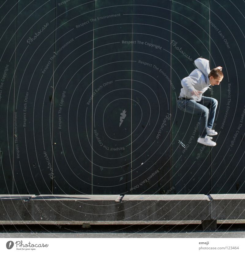 JUMP again Man Wall (building) Going Jump Hop Barrier Turquoise Human being Lucerne Green Background picture Youth (Young adults) Joy Playing go up young