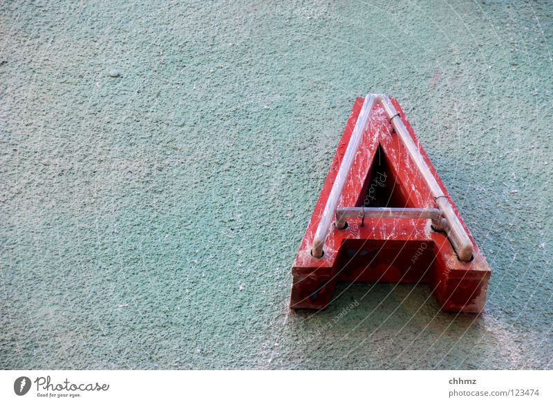 A Facade Characters Old Dirty Broken Green Red Advertising Neon sign Neon light Decompose Letters (alphabet) Subdued colour Exterior shot Deserted