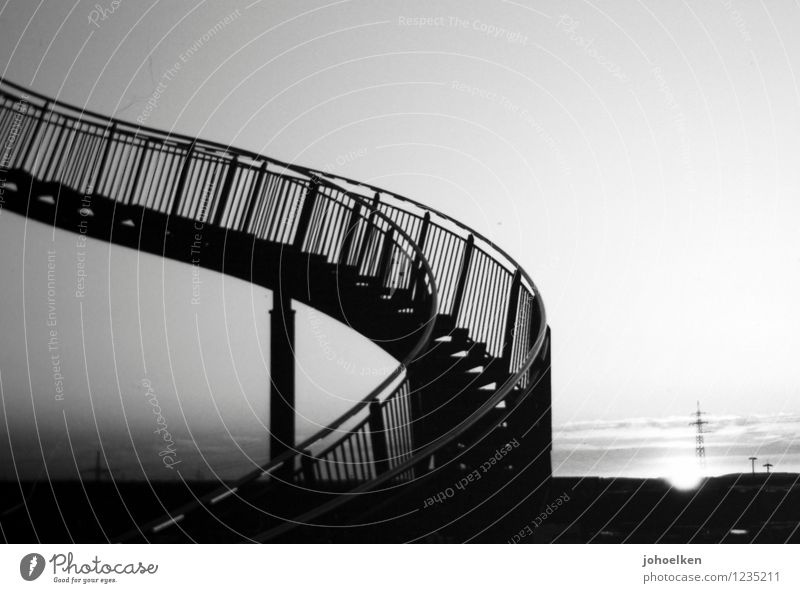 Upstairs, downstairs. Art Work of art Tiger and Turtle Cloudless sky Sunrise Sunset Sunlight Beautiful weather Duisburg Stairs Tourist Attraction Hang Creepy