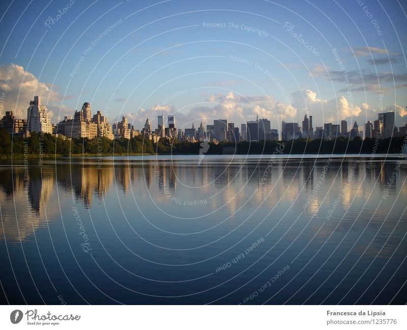 Smooth as a mirror Water Sky Clouds Horizon New York City USA Americas Town Skyline Deserted House (Residential Structure) High-rise Blue Gold Calm Wanderlust