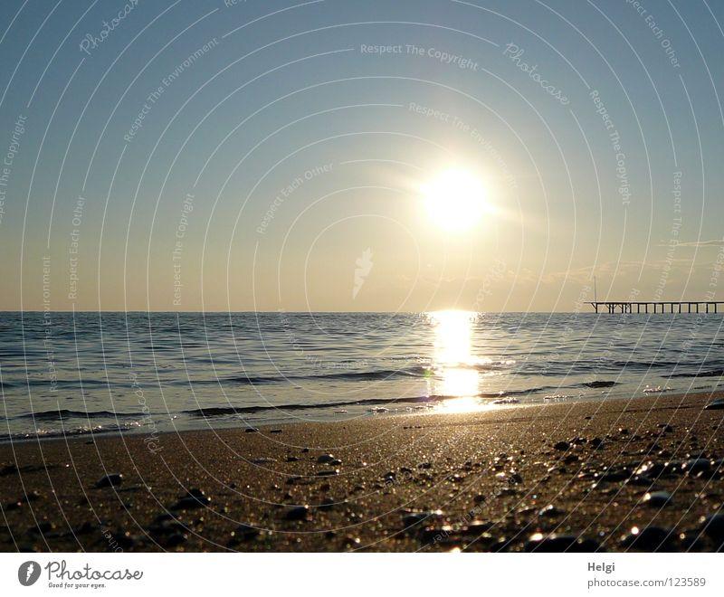 Evening sun on the beach on the coast of the Mediterranean Sea Sun Sunset Moody Dusk Lighting Reflection Ocean Sea water Waves Beach Coast Pebble