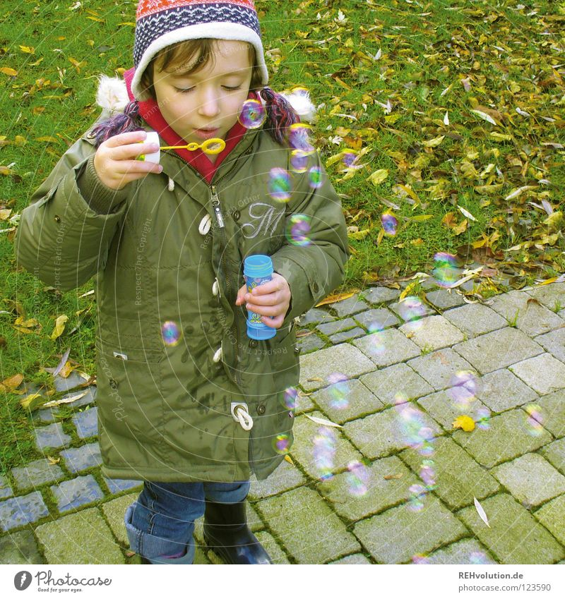 children joys Child Playing Toddler Kindergarten Soap bubble Impish Boy (child) Cold Winter Green Cap Blow Small Sweet Joy Multiple Air Looking soap soapy water