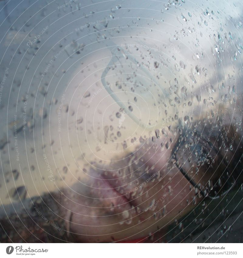 hmmmm Rain Look out Grief Bad weather Reflection Looking Moody Dark Damp Wet Future Vantage point Eyeglasses Woman Facial expression Blur Winter Gray Dreary