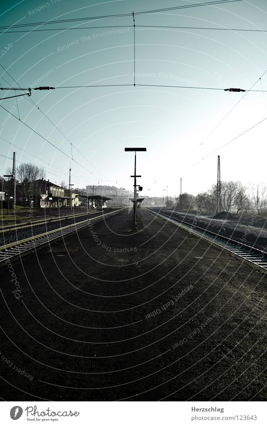 at odds Lanes & trails Cyan Railroad Speed Railroad tracks Long Wide angle Traffic infrastructure Train station Blue Sky unendingly