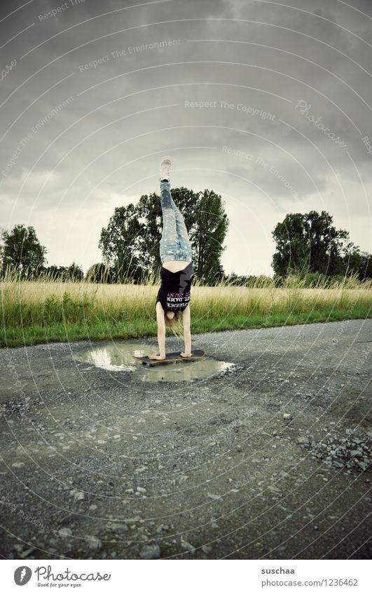 Child Girl Lanes & trails Wet Footpath Asphalt Athletic Skateboard Puddle Handstand