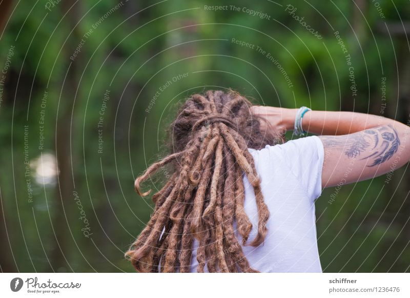 Human being Woman Youth (Young adults) Green Young woman Adults Feminine Hair and hairstyles Arm Back Photography Driving Tattoo Photographer Take a photo Dreadlocks