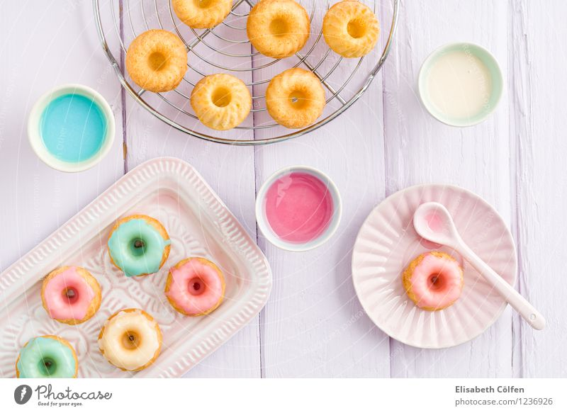 Mini-Gugelhupf cake Food Dessert Candy glaze Cake Nutrition To have a coffee cake rack Bright Blue Yellow Violet Pink Ingredients enamel Icing Colour photo
