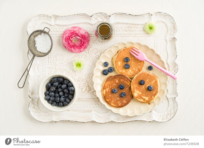 Blueberry Pancakes Dessert pancake Confectioner`s sugar Fork Sieve Tray maple syrup Flower Nutrition To have a coffee Plate Jump Pink Colour photo Studio shot