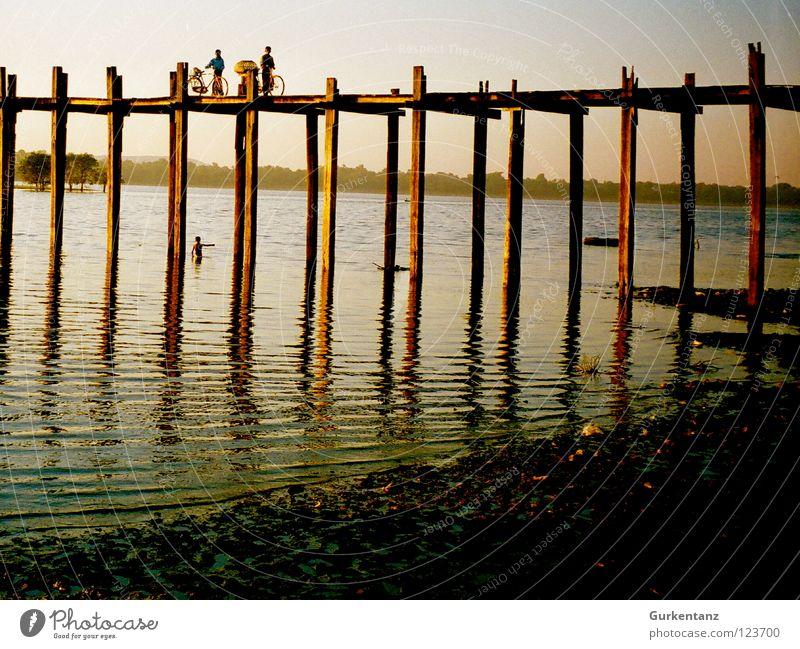 Bridge over silent water Myanmar Mandalay Teak Wood Wooden bridge Asia Dusk Lake Burmese Transport River Brook u-leg Pole Evening Water Shadow Silhouette