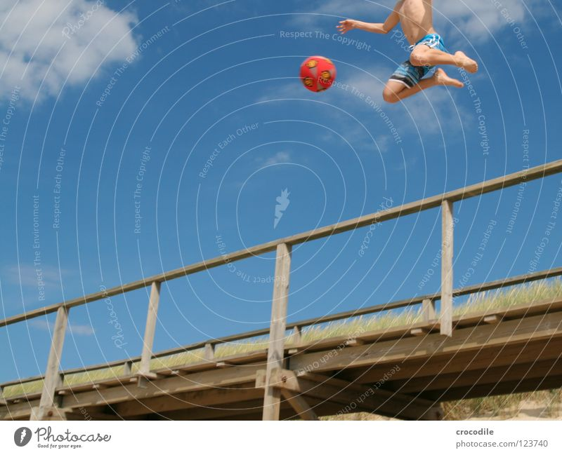 angel football Sylt Beach Footbridge Pants Shoot Playing Jump Air Hover Headless Clouds Worm's-eye view Red Joy Funsport Ball To fall Movement Sand Arm Feet