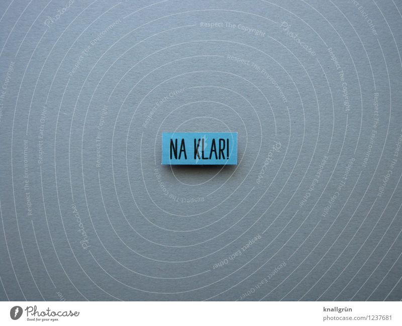 NA KLAR! Characters Signs and labeling Communicate Sharp-edged Blue Gray Black Emotions Enthusiasm Optimism Resolve Sure thing. Colour photo Studio shot
