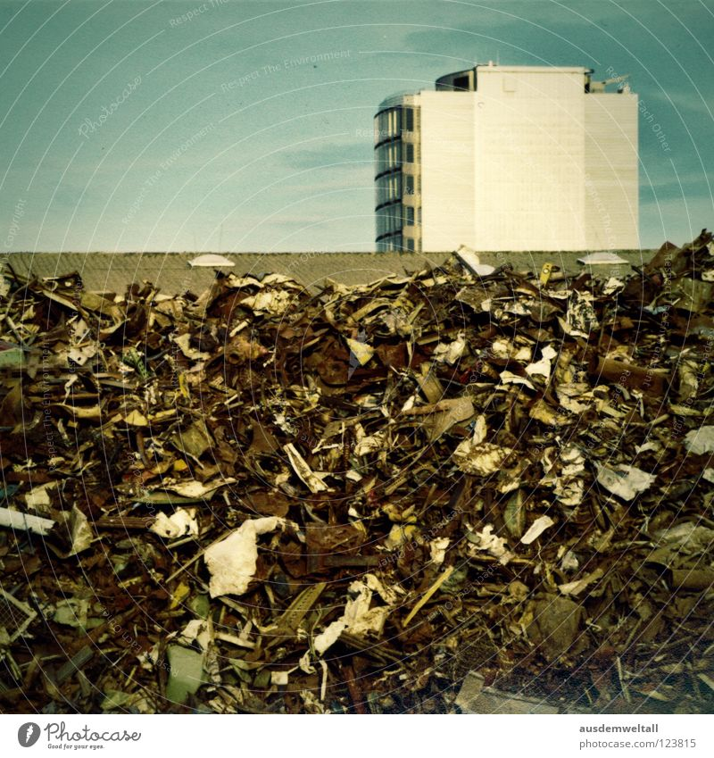 :.High..: House (Residential Structure) Trash Scrap metal Light blue Balcony Roof Colour Sky Tall Mountain Dirty Living or residing Bright Above Rust