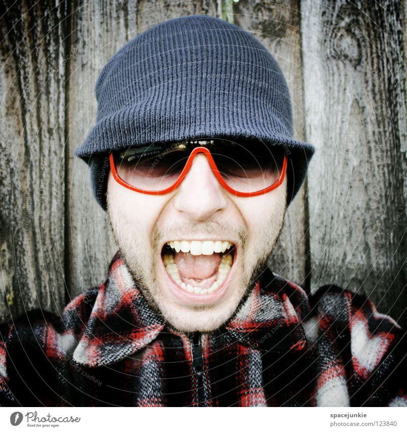 Rock it! (2) Man Portrait photograph Freak Scare Wall (building) Wood Eyeglasses Sunglasses Cap Winter Cold Freeze The eighties Easygoing Whimsical Humor Joy