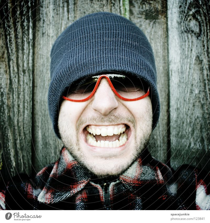 Rock it! (3) Man Portrait photograph Freak Scare Wall (building) Wood Eyeglasses Sunglasses Cap Winter Cold Freeze The eighties Easygoing Whimsical Humor Joy