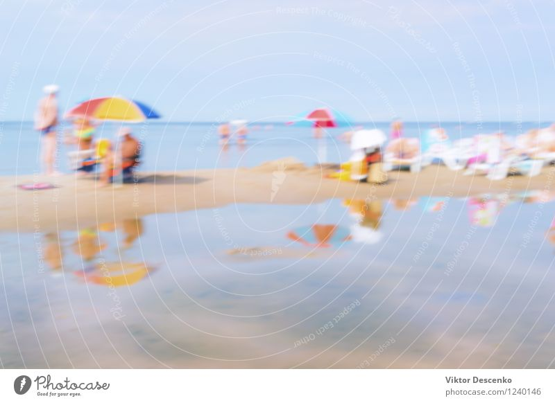 Vacationers people on a day in the summer sea beach Sky Nature Vacation & Travel Blue Beautiful Summer White Sun Ocean Beach Natural Lifestyle Sand Tourism Table Seasons