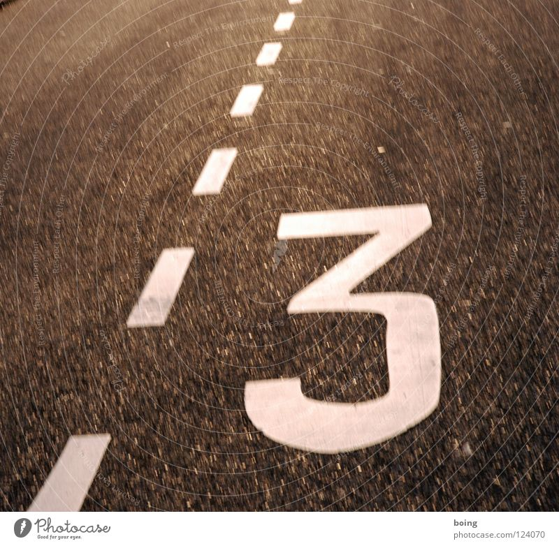Digits and numbers Traffic infrastructure Triangle Street sign Designer stubble Tricycle Lane markings Triad