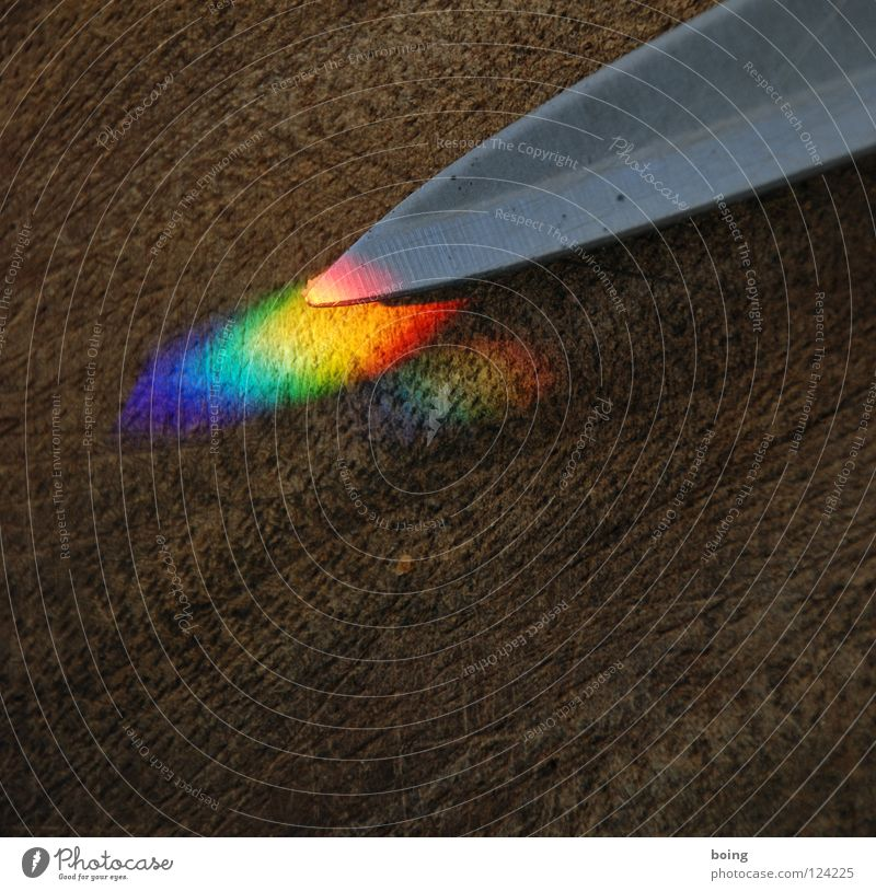 the white knight with the orange glowing blade Rainbow Refraction Prism Prismatic colour Light Radiation Halo RGB Green Yellow Red Mix Multicoloured