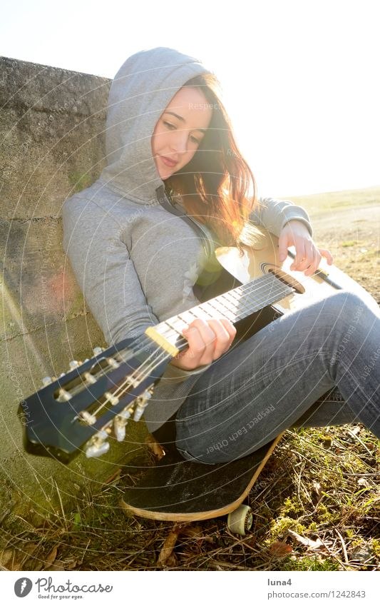 guitar Lifestyle Joy Playing Music Skateboard Human being Feminine Woman Adults Youth (Young adults) 1 18 - 30 years Friendliness Gray Joie de vivre (Vitality)
