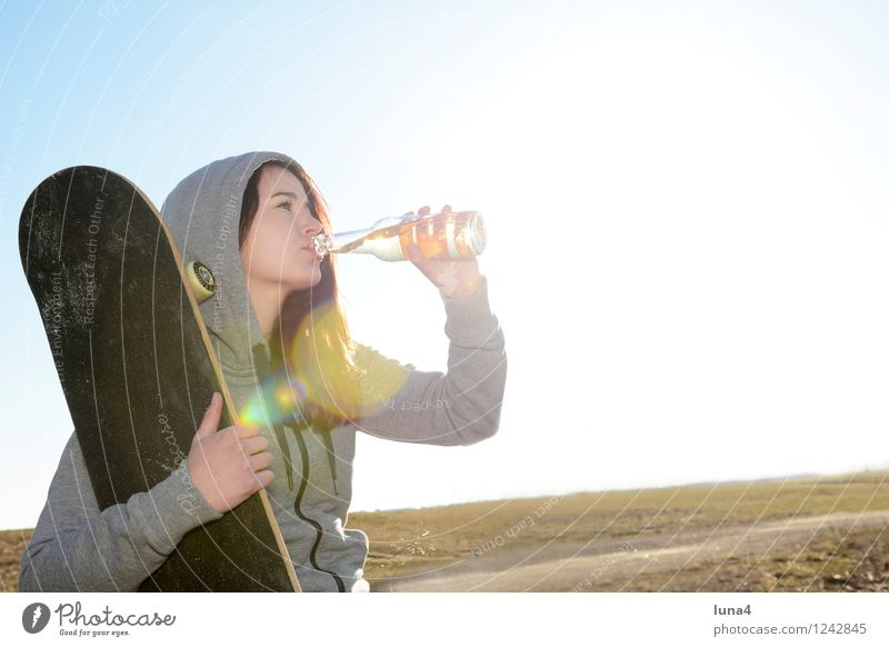 young woman with skateboard Beverage Drinking Cold drink Lemonade Beer Bottle Lifestyle Human being Feminine Woman Adults Youth (Young adults) 1 18 - 30 years