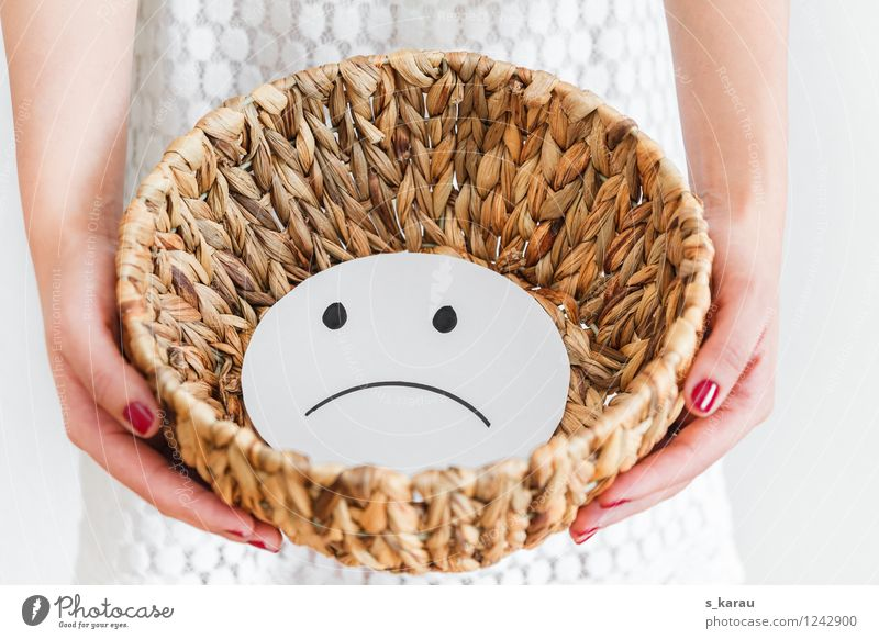 rebuffed Unemployment Feminine Arm Hand Fingers Basket Sign Smiley Sadness White Emotions Moody Frustration Loneliness Disappointment Expectation Cold Pain