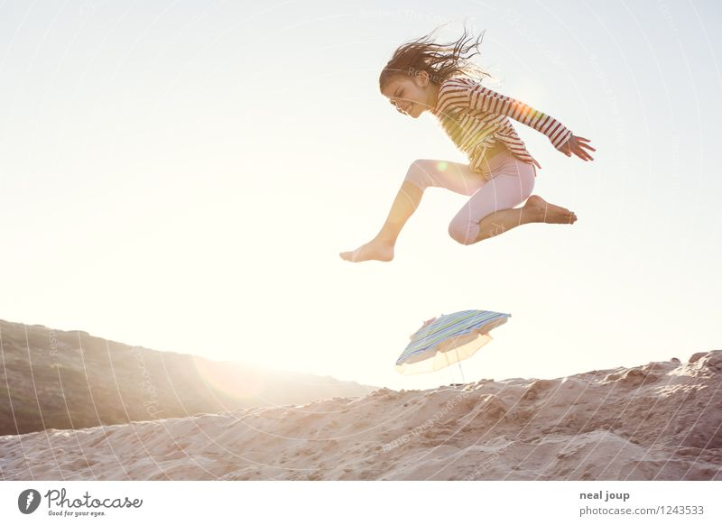 Jump for Joy -II- Girl 1 Human being 3 - 8 years Child Infancy Summer Beautiful weather Beach Portugal Long-haired Movement Flying Romp Happiness Happy