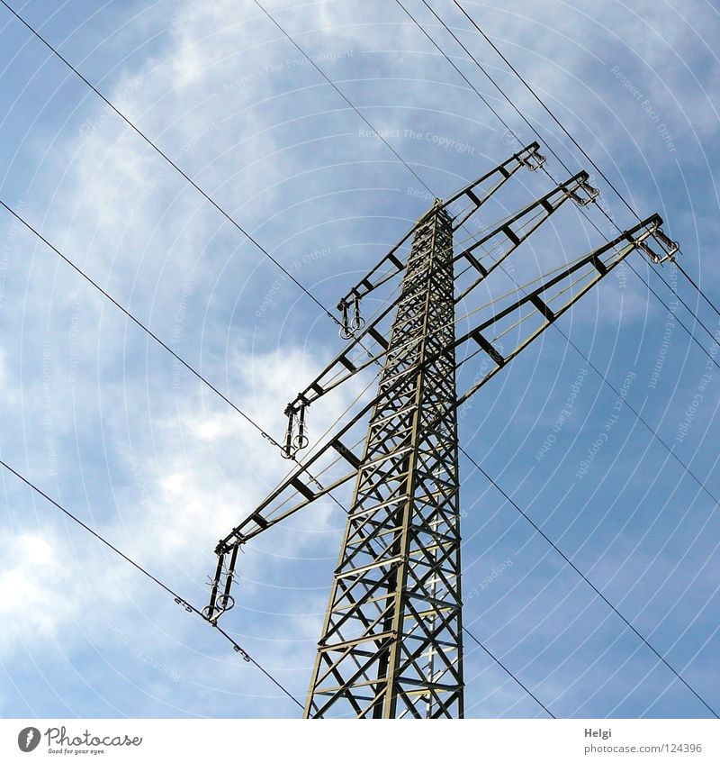 gigantic power pole with power cables in front of blue sky with clouds Electricity pylon Wire Clouds White Gray Large Might Geometry Steel Towering Dangerous