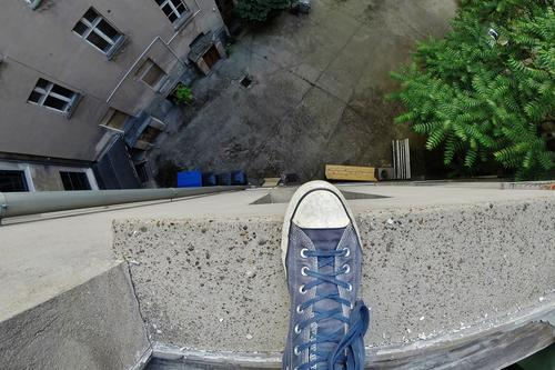 Human being Berlin Feet Flat (apartment) Fear Living or residing Footwear Old town Backyard Old building Courtyard Hopelessness Suicide victim
