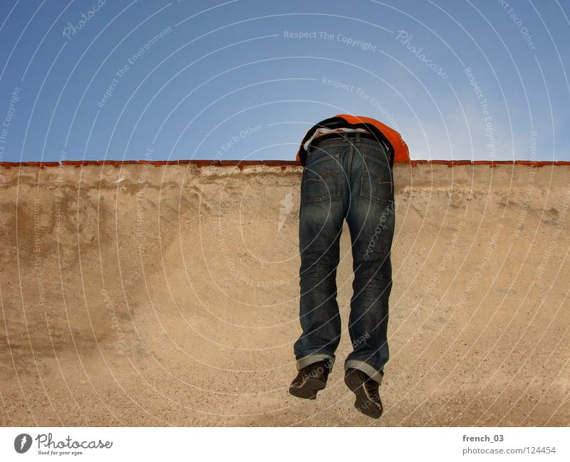 wall hanger Human being Sky Man Blue Red Black Relaxation Far-off places Yellow Wall (building) Above Movement Freedom Wall (barrier) Jump Orange