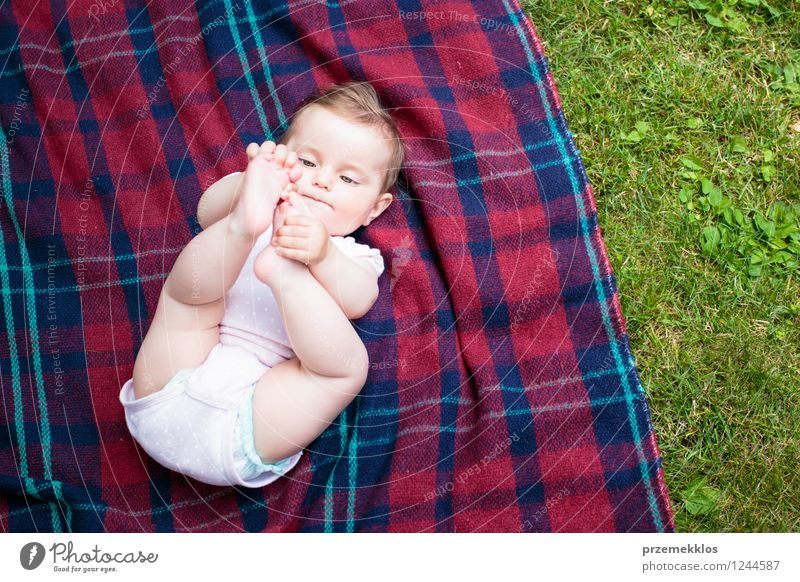 Baby lying on blanket in the garden Human being Nature Green Summer Girl Spring Grass Small Garden Park Cute Checkered 0 - 12 months