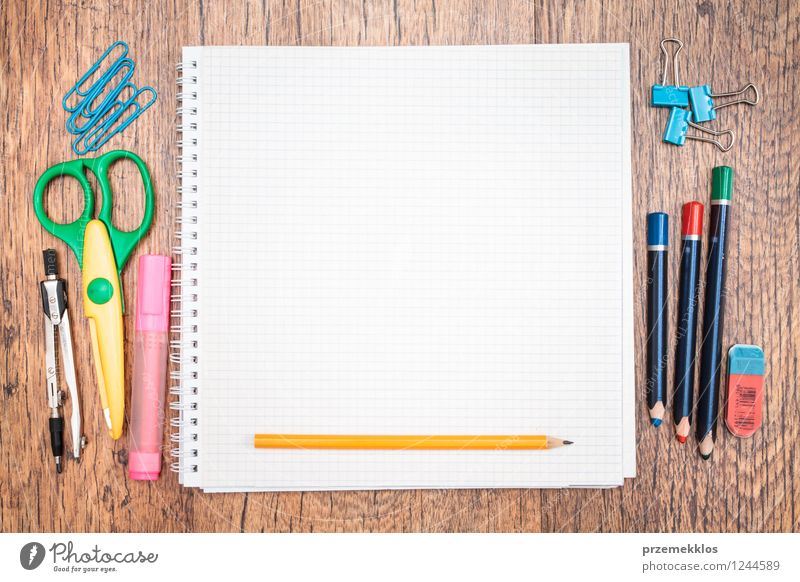 Notepad with pencil and other accessories School Work and employment Study Paper Education Desk Pen Tool Workplace Piece of paper Pencil Crayon Object photography Scissors Supply Blank