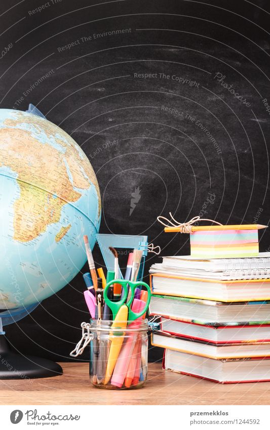 School accessories with blackboard in the background Desk Blackboard Study Workplace Tool Scissors Scale Book Earth Pen Globe Education Blank brush Crayon