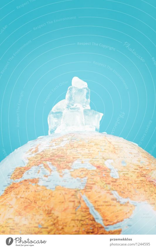 Globe with melting ice cubes Save Environment Nature Earth Climate Climate change Warmth Water Hot Blue End Idea berg depict global Iceberg North peak Planet