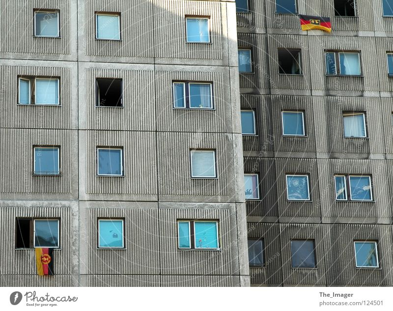 What is it now? Flag Nostalgia Reunification Coat of arms German Flag Prefab construction East Germany Gray Flat (apartment) Window