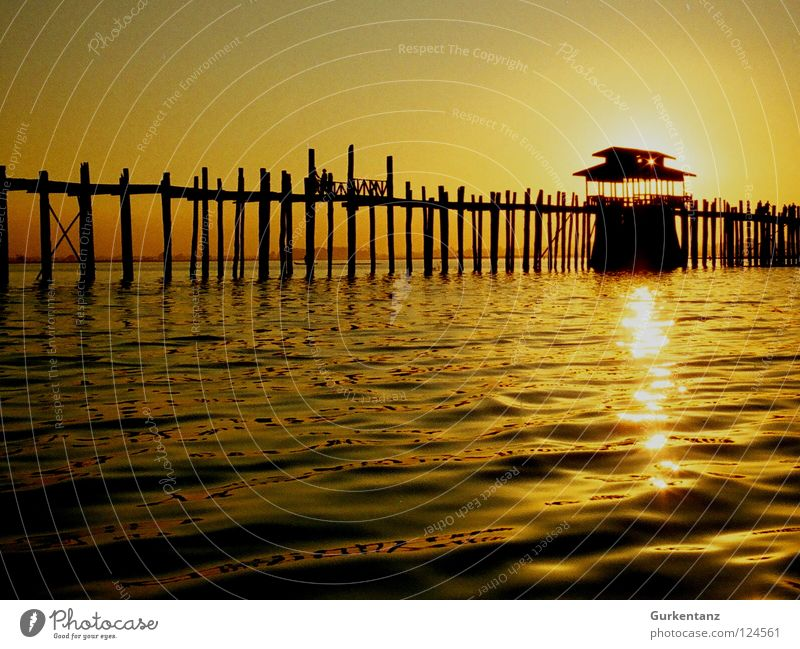 solar power station Myanmar Mandalay Teak Wood Wooden bridge Asia Dusk Lake Back-light Light Bridge Celestial bodies and the universe u-leg Pole Evening Water